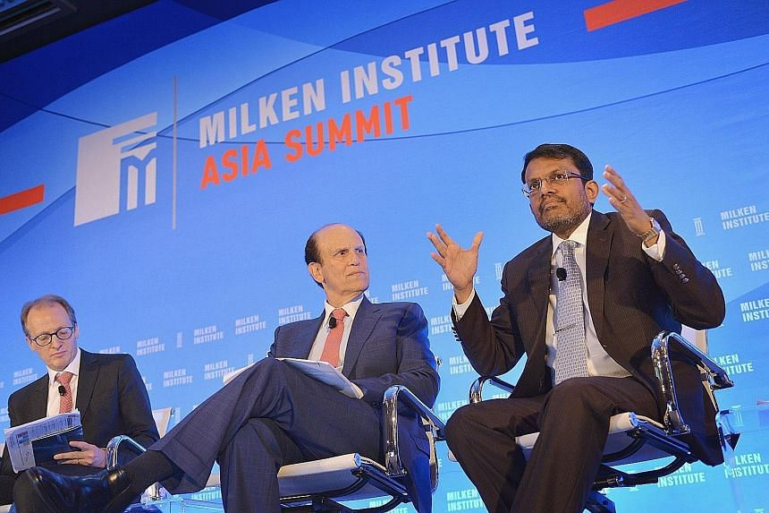 From left: Moderator Jonathan Woetzel, director of McKinsey Global Institute and senior partner, Shanghai, McKinsey & Co; chairman of Milken Institute Michael Milken; and Mr Menon at the Milken Institute Asia Summit 2016 yesterday.