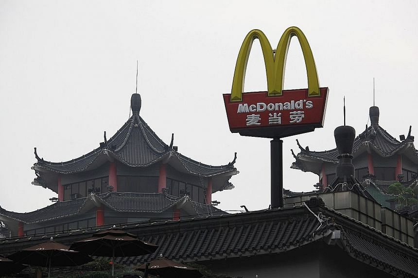 China's first McDonald's outlet, which opened in 1990 at the southern city of Shenzhen. McDonald's Corp has received final bids from at least three groups for its China and Hong Kong outlets, with global private equity firms Carlyle Group and TPG Cap