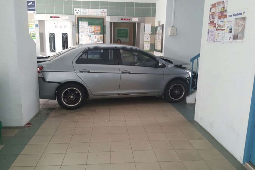 A car crashed into the void deck of Block 791, Woodlands Avenue 6 on Sept 16, 2016.