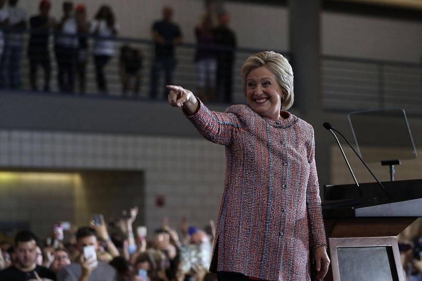 Democratic presidential nominee former Secretary of State Hillary Clinton greets supporters during a campaign rally at UNC Greensboro in North Carolina on Sept 15, 2016.