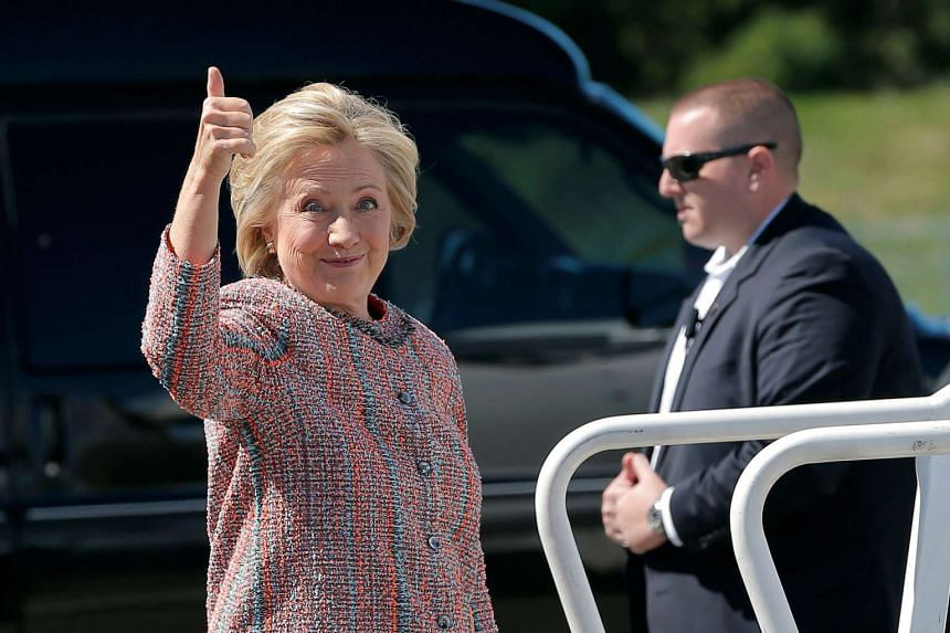 Hillary Clinton gives a thumbs up as she boards her campaign plane in White Plains, New York, on Sept 15, 2016.