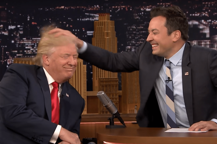 Jimmy Fallon (right) messing up Donald Trump's hair during his talk show.