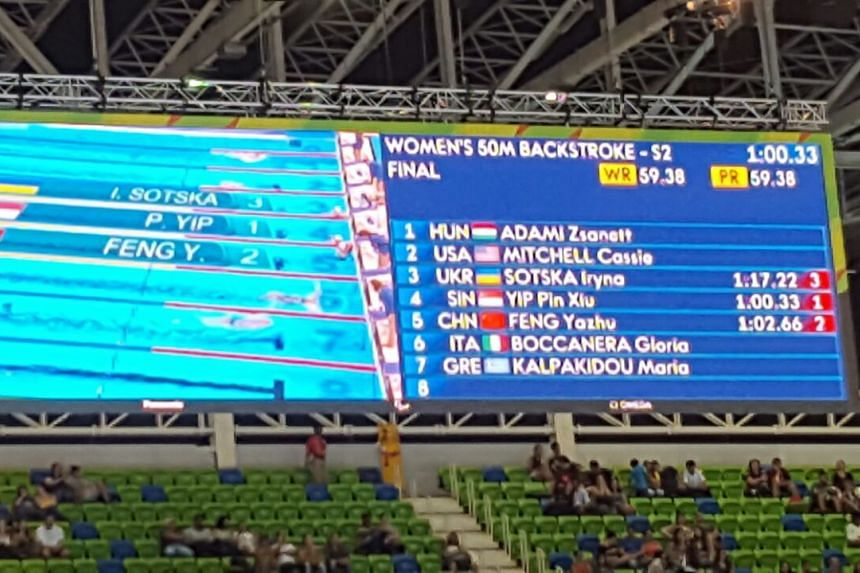 The scoreboard shows the timing of the swimmers for the 50m backstroke S2 on Sept 15, 2016.