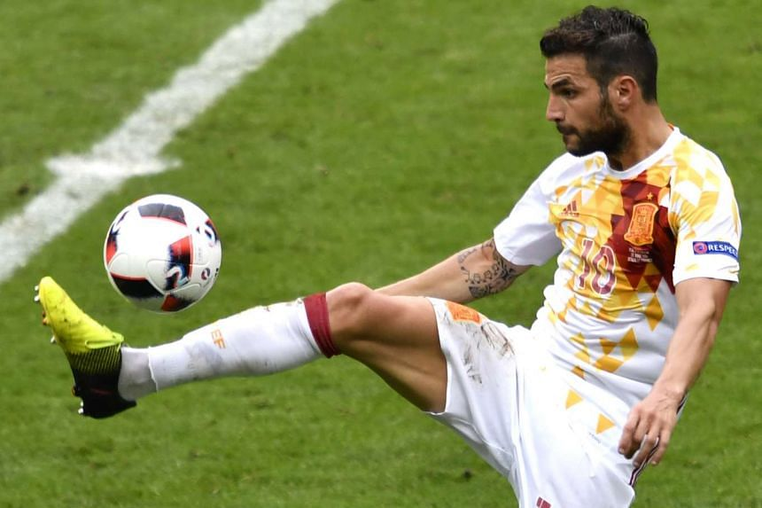 Midfielder Cesc Fabregas (above) must improve the defensive side of his game to earn a place in Chelsea's starting line-up, manager Antonio Conte has said.