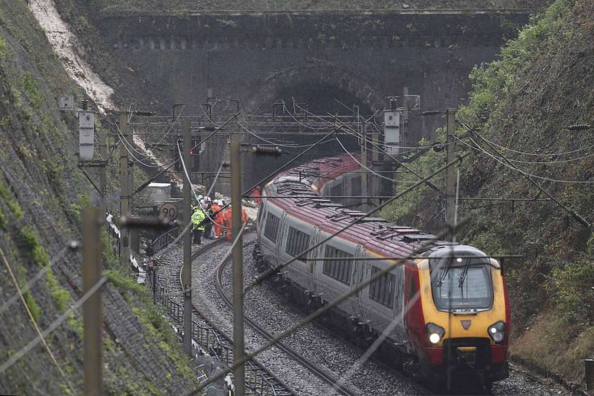 Emergency services and rail workers attend the scene of a train derailment on the Euston to Milton Keynes line, at Hunton Bridge tunnel in Britain on Sept 16, 2016.