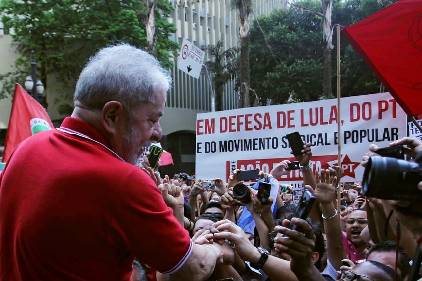 Lula greets supporters after giving a news conference in Sao Paulo, Brazil, Sept 15, 2016.