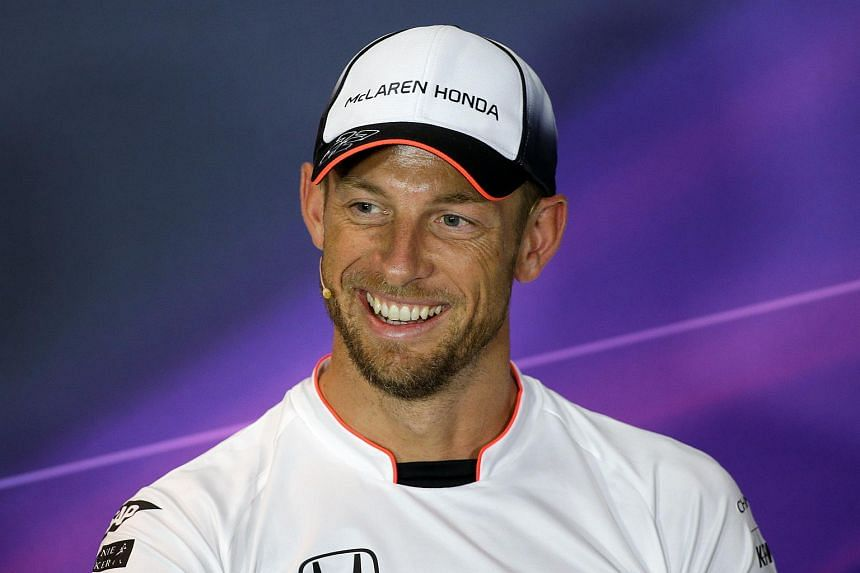 McLaren's Jenson Button of Britain smiles during a news conference on Sept 1, 2016.