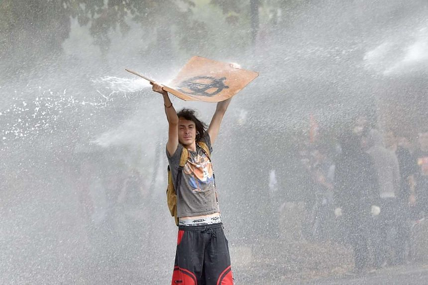 Police use water cannon against a demonstrator in Nantes, western France, on Sept 15, 2016.