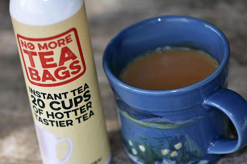 A cup of tea made from a No More Tea Bags aerosol can.