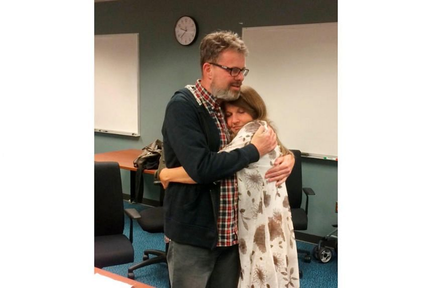 Kevin Garratt hugs his wife Julia Garratt after being deported by Chinese authorities.
