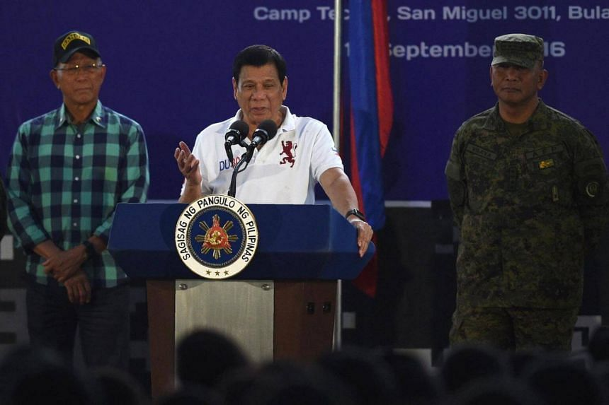 Philippine President Rodrigo Duterte (centre) delivers a speech before members of the Scout Rangers regiment at a military training camp in San Miguel town, Bulacan province, north of Manila on Sept 15, 2016.