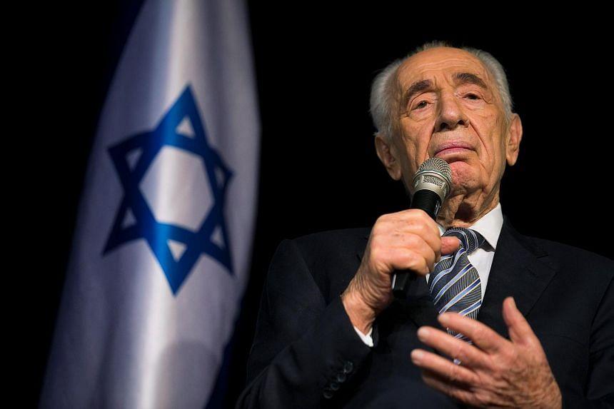Former Israeli president Shimon Peres speaks during a news conference on July 6, 2014.