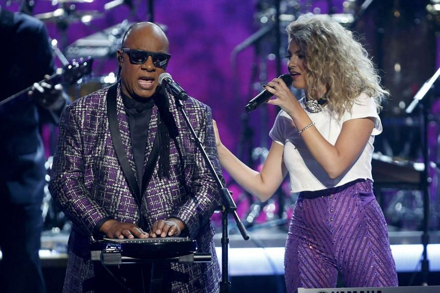 Stevie Wonder performing at the BET Awards in Los Angeles in June 2016 with Tori Kelly.