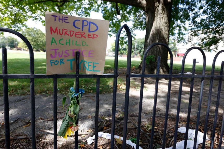 A sign on a fence near the scene where police shot and killed 13-year-old Tyree King in Columbus, Ohio.