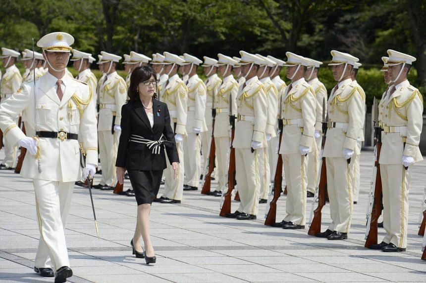 Japan's defence minister Tomomi Inada (centre) reviewing a guard of honour at the Ministry of Defense in Tokyo, Japan, in this photo taken by Kyodo, on Aug 4, 2016.