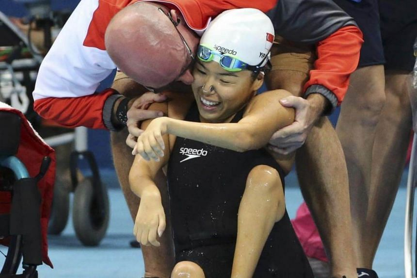 Mick Massey congratulates Yip Pin Xiu after she wins gold for the 50m backstroke S2 on Sept 15, 2016.