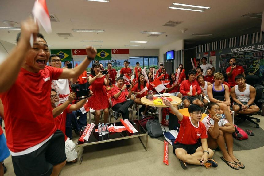 Minister Tan Chuan-Jin (second from left), TeamSG athletes and supporters at the Singapore Sports Institute cheer as Yip Pin Xiu wins the S2 50m backstroke Rio Paralympics final on Sept 16, 2016.