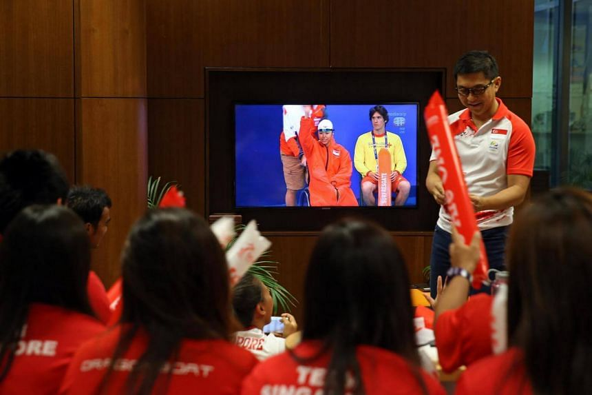 Minister Tan Chuan-Jin and supporters at the Singapore Sports Institute cheer as Yip Pin Xiu wins the S2 50m backstroke Rio Paralympics final on Sept 16, 2016.