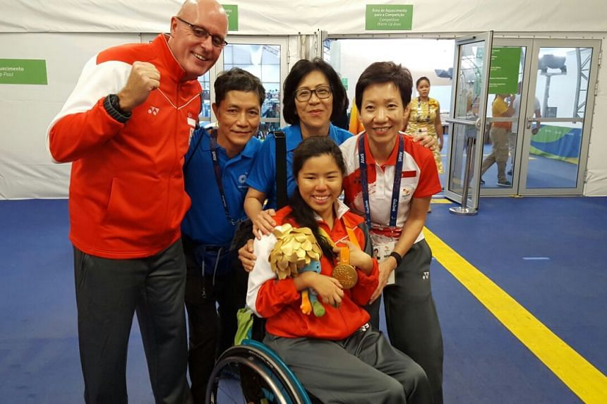 Mick Massey (left), Yip Pin Xiu, her parents, and Grace Fu celebrate after the medal ceremony at the 2016 Rio Paralympics on Sept 15, 2016.