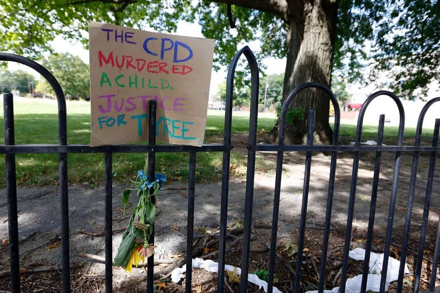 A sign on a fence on 18th street near East Capital Street, near the scene of a police shooting of 13-year-old Tyree King in Columbus, Ohio.