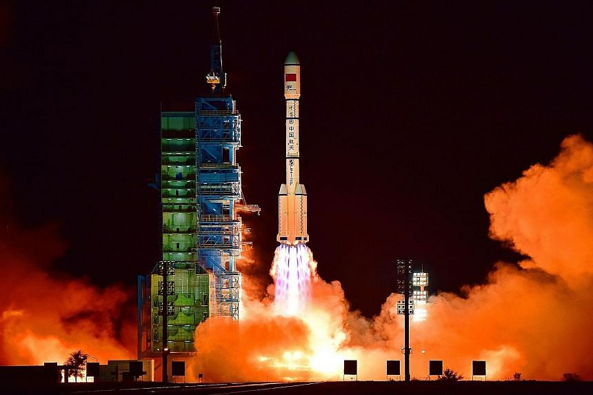 China's Tiangong 2 space laboratory being launched from the Jiuquan Satellite Launch Centre in the Gobi Desert, in Gansu province, on Thursday. The Shenzhou 11 spacecraft, which will carry two astronauts and dock with Tiangong 2, will be launched som