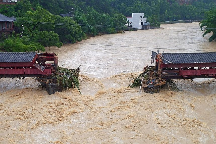 Part of an ancient bridge in Yongchun, Fujian province, was swept away as Typhoon Meranti made landfall in south-east China on Thursday. Some 1.65 million households are without power in the province.