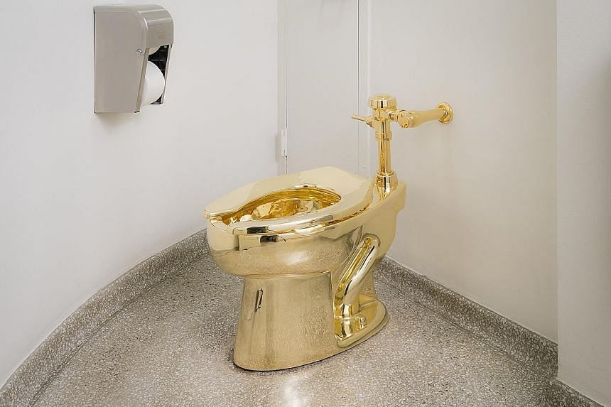 Italian artist Maurizio Cattelan's solid 18K-gold copy of a Kohler toilet in a restroom of the Solomon R. Guggenheim Museum.