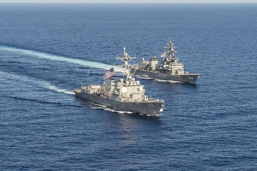 US and Japanese military vessels during bilateral training in the South China Sea in April last year. Japan's increased engagement in the South China Sea would include capacity building for coastal nations, said Defence Minister Tomomi Inada.