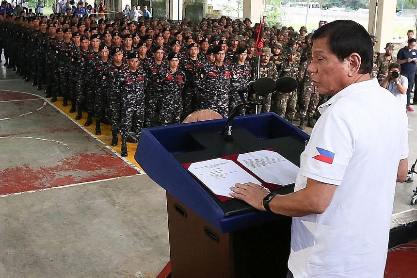 President Duterte addressing the Philippine Army Scout Rangers at their headquarters in San Miguel on Thursday. Mr Duterte has been accused of giving orders to kill not just criminals but also his opponents.