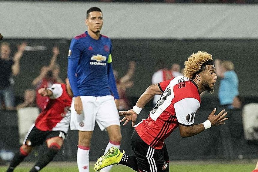 Tonny Vilhena (in red) of Feyenoord celebrating after scoring against Manchester United in their Europa League clash. The match ended 1-0 in favour of Feyenoord and gave Jose Mourinho a second successive defeat as United manager.