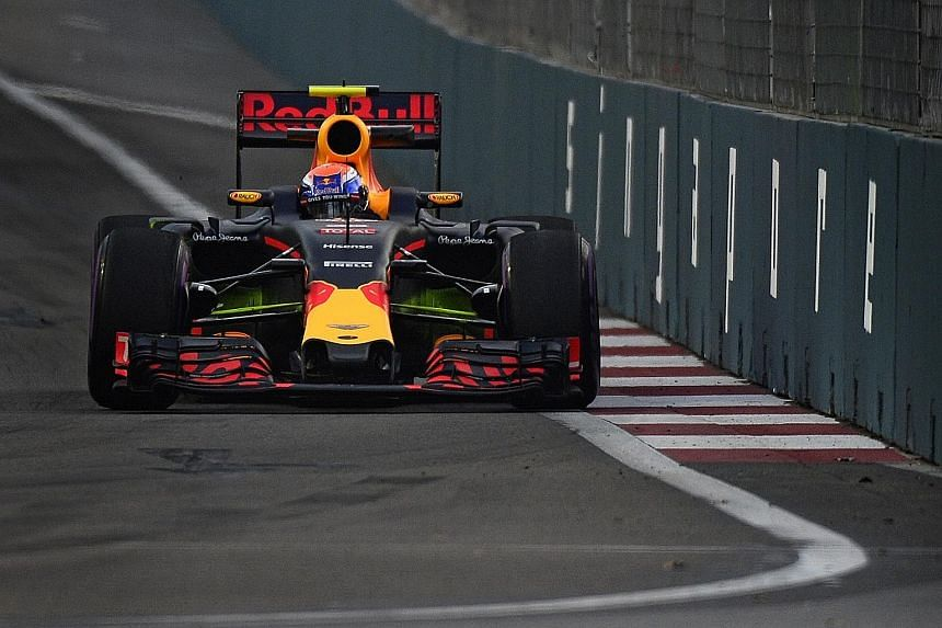 Red Bull's Max Verstappen approaching Turn 14 during the first Singapore Grand Prix practice session at the Marina Bay street circuit. The Dutchman completed the third fastest lap of the day in 1min 44.532sec, 0.380sec behind the pace-setter Nico Ros
