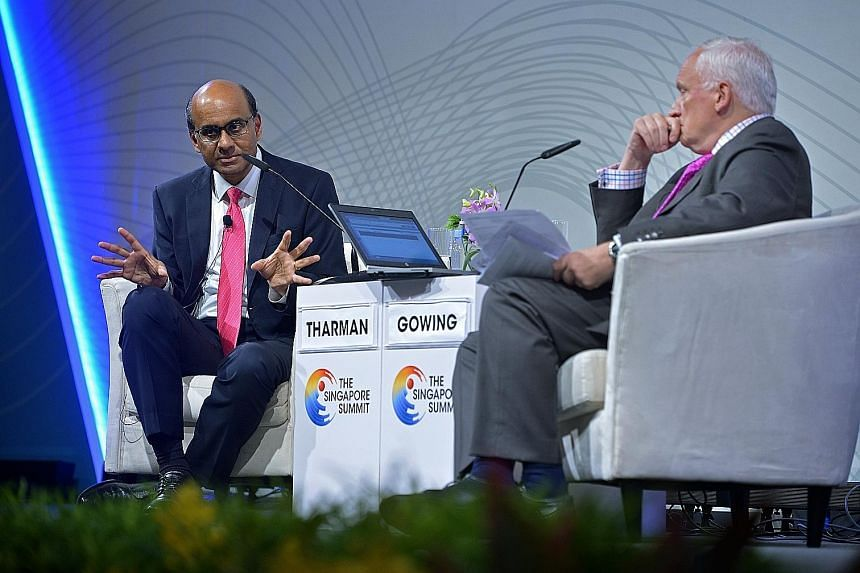 Deputy Prime Minister Tharman Shanmugaratnam with moderator Nik Gowing at a dialogue at the Singapore Summit yesterday. The jobs of governments and educators are more difficult as change is happening far more frequently, Mr Tharman said. This means i