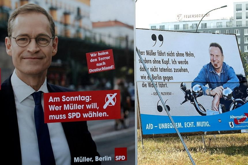 Election posters for Mr Mueller of the Social Democratic Party and Mr Pazderski of the anti-immigration party Alternative for Germany in Berlin. The German city prides itself on being culturally diverse and tolerant.