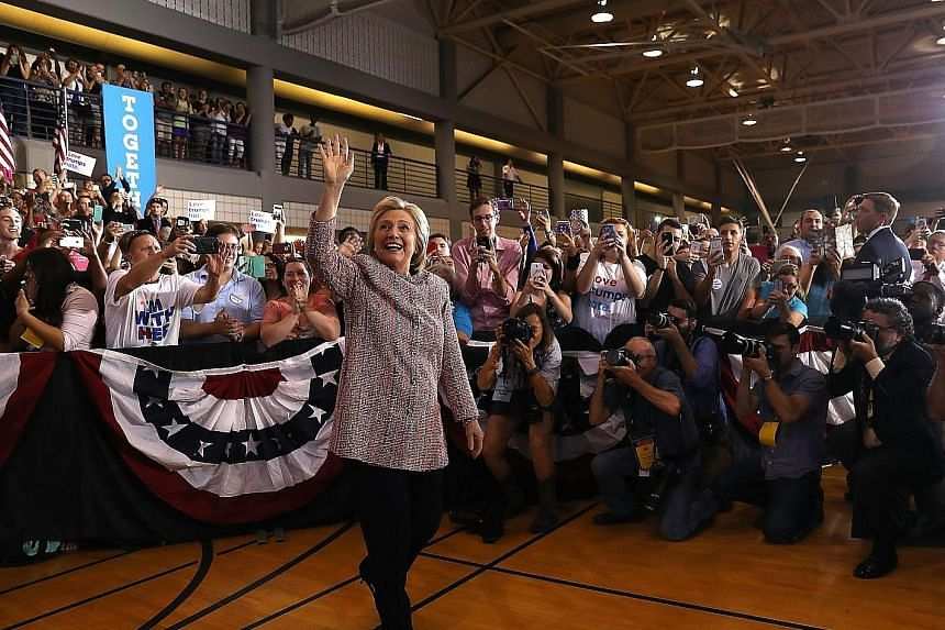 Mrs Clinton at her rally in Greensboro, North Carolina, where she sought to refocus her campaign on the plight of the working class, which has been a potent theme for Republican rival Donald Trump.