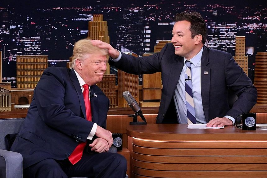 Mr Trump grinning as Fallon messed up his hair with a vigorous rub, causing his long locks to point messily every which way.