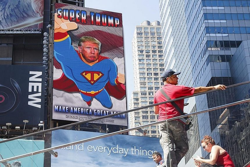 """A New York City billboard in support of the Republican presidential nominee. On the subject of Mr Obama's place of birth, Mr Trump said in an interview: """"I'll answer that question at the right time."""""""