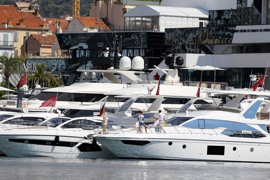 """Yachts are pictured in Cannes on Sept 6, 2016, as part of the annual the """"Yachting Festival""""."""