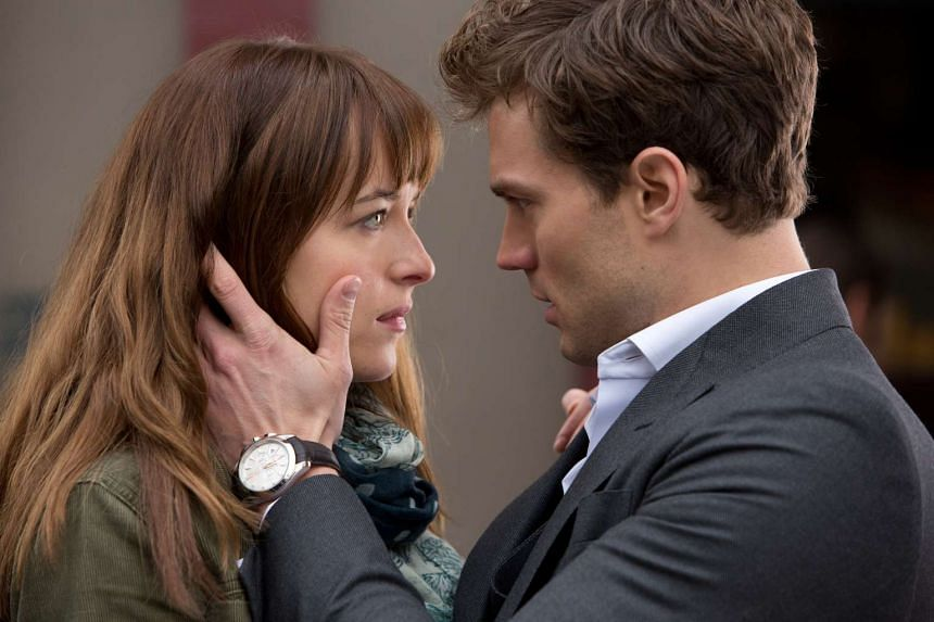 Actors Dakota Johnson (left) and Jamie Dornan in a still from the Fifty Shades Of Grey movie.