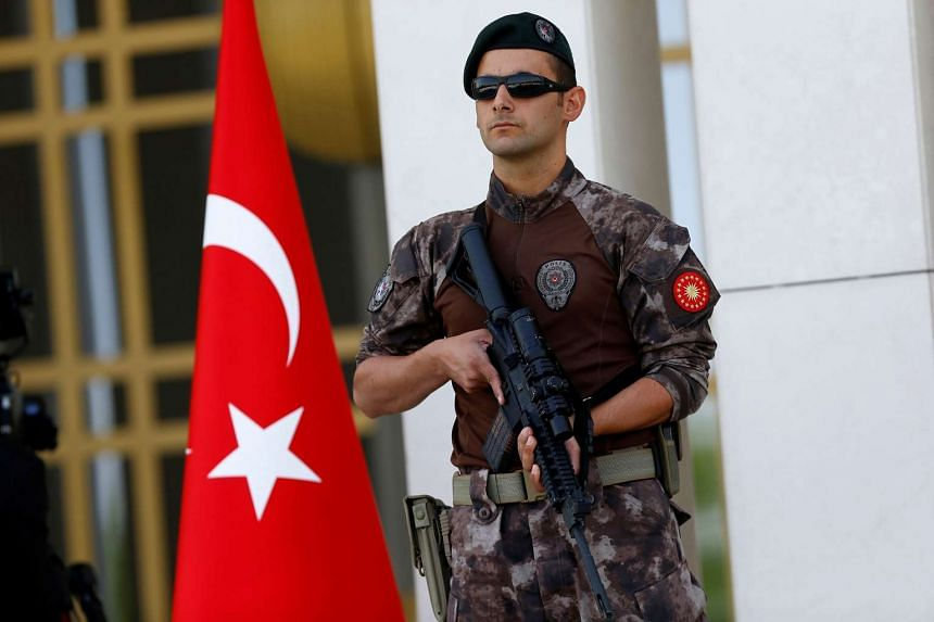 A Turkish special forces police officer guards the entrance of the Presidential Palace in Ankara on Aug 5, 2016.