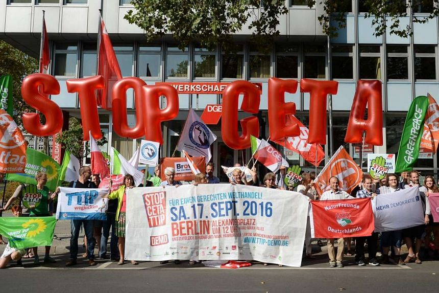 "Members of the ""Stop CETA & TTIP"" alliance rally in Berlin on Sept 14, 2016."