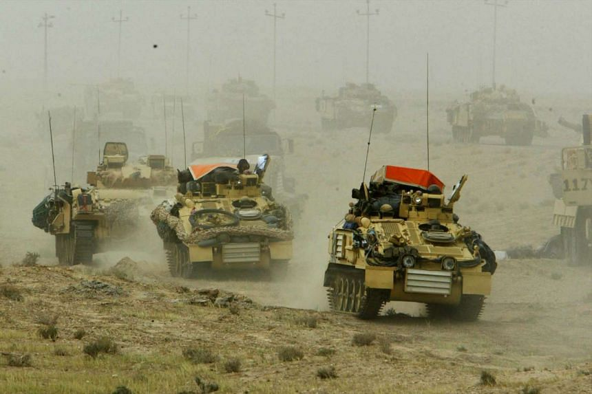 A British army armoured vehicle convoy rolling into southern Iraq on March 22, 2003.