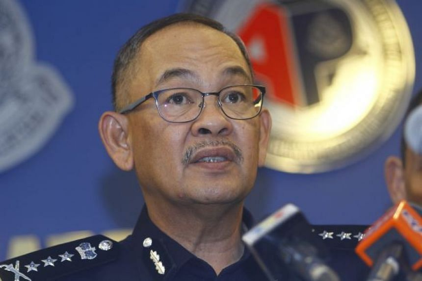 State police chief Datuk Abdul Ghafar Rajab clarified that images of policemen in combat gear were dated and not recent.