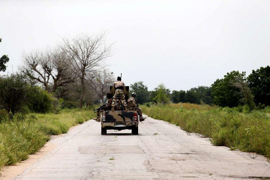 A military vehicle drives along the Konduga-Bama road in Bama, Borno, Nigeria.