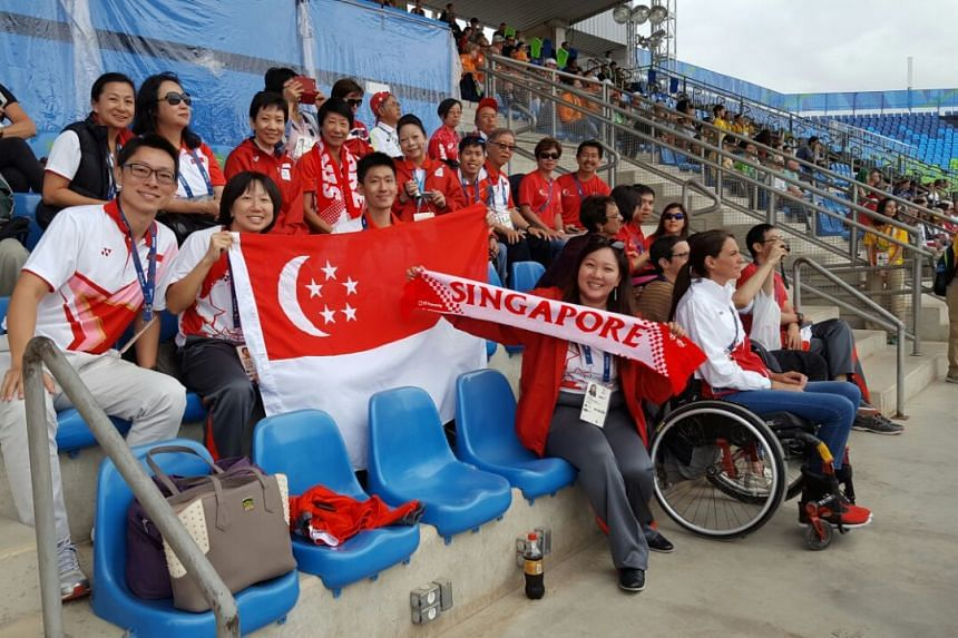 Singapore supporters before Laurentia Tan, 37, goes into the arena.