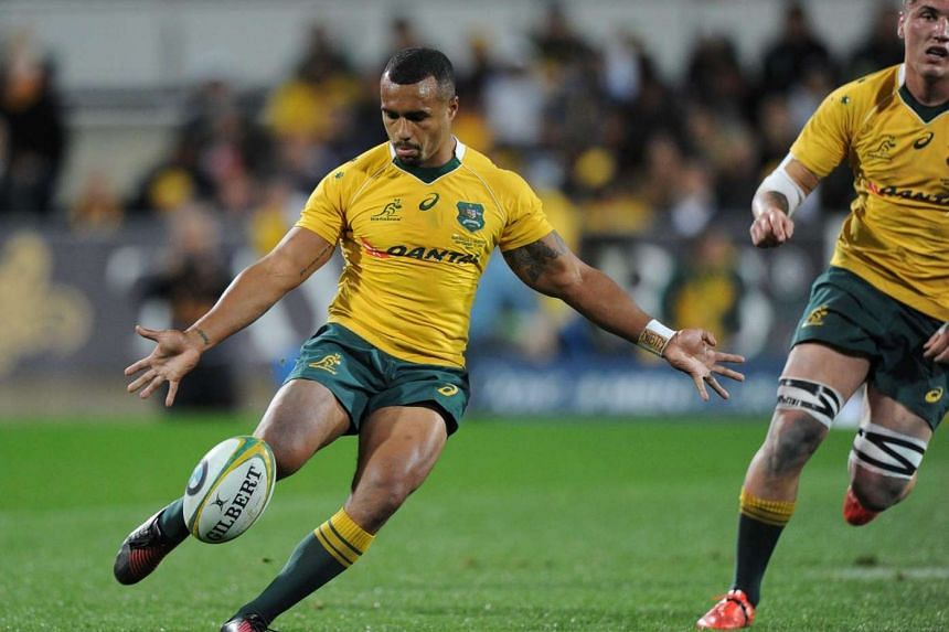Australian player and man of the match Will Genia (centre) kicks the ball during the Rugby Championship match between Australia and Argentina in Perth on Sept 17, 2016.