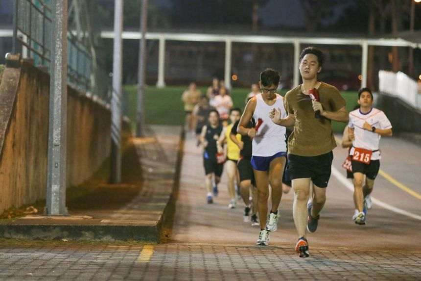 NSmen running as part of their IPPT Preparatory Training (IPT) programme in Maju Camp.