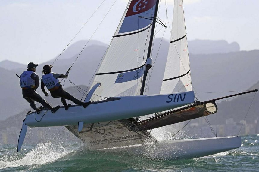 Justin Liu and Denise Lim of Singapore compete in a mixed multi-hull sailing event at the 2016 Rio Olympics.