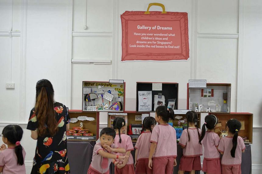 At St James' Church Kindergarten yesterday, some of its pupils' community projects and dreams for Singapore were presented as craft work displayed in red boxes at the kindergarten's campus in Newton