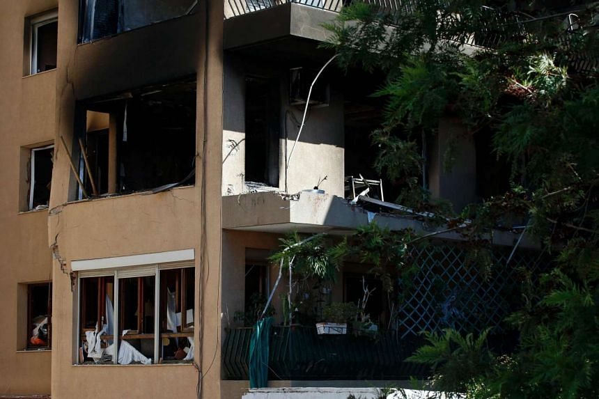 A picture taken on Sept 18, 2016 shows a damaged seven-storey building following an explosion in Premia de Mar, near Barcelona.