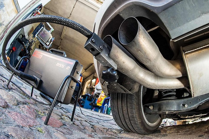 A measuring hose for emission inspections of diesel engines attached to the exhaust of a VW Golf 2.0 TDI in Germany. The bulk of affected cars here are 1.6-litre models, including 600 Tourans and 314 Caddys.
